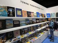 A visitor browses a book at Turkey's booth (photo: AP)