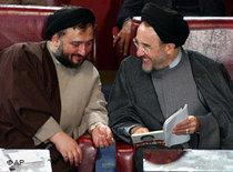 Mohammad Ali Abtahi, left, and Mohammad Khatami, talk in an open session of parliament in Tehran, April 2004 (photo: AP)