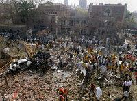 Pakistani rescue and security officials examine the site of a bomb explosion at the office of the Federal Investigation Agency in Lahore, Pakistan on 11 March 2008 (photo: AP)