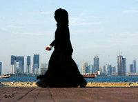 Veiled woman in front of the skyline of Doha, Qatar (photo: AP)