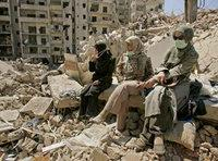 Three women in Gaza rubble (photo: AP)