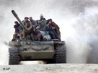 Taliban fighters on a tank in Northern Afghanistan (photo: AP)