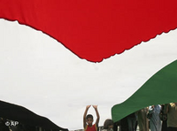 Palestinian boy and Palestinian flag during a rally in Gaza (photo: AP)
