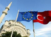 Turkish and EU flags, with an Istanbul mosque in the background (photo: AP)