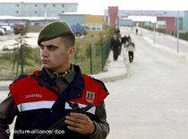 A Turkish policeman outside Silivri prison, Istanbul (photo: dpa)