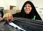 Iraqi woman casting her vote (photo: AP)