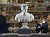 A woman reads a book in the restored Duchess Anna Amalia library (photo: AP)