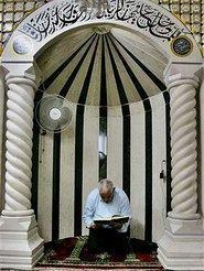 A man praying in a mosque (photo: AP)