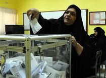 A Kuwaiti woman casting her vote in the town of Salwa (photo: AP)