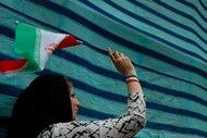 A female supporter of President Ahmadinejad in Tehran after the election (photo: Roshy Zangeneh)