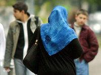 Woman wearing a headscarf (photo: AP)