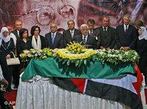 Mahmoud Abbas (centre) at Darwish's funeral ceremony (photo: AP)
