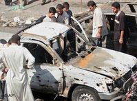 Car, destroyed by suicide bomber, Balad, Iraq (photo: AP)