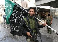 Palestinian militant in the area of Sidon, South of Lebanon (photo: AP)