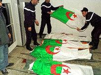 Algerian police force cover the bodies of the dead in the Algerian national flag after an attack by militant Islamists (photo: AP)