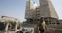 Destroyed buildings in front of the Iraqi Ministry of Finanance (photo: AP)