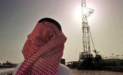 Saudi man in traditional garb at an oil site (photo: AP)