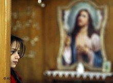 A Christian girl in a church in Iraq (photo: AP)