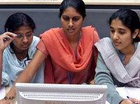 Working women in India at a PC (photo: AP)