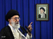 Ali Khamenei infront of Khomeini's picture (photo: AP)