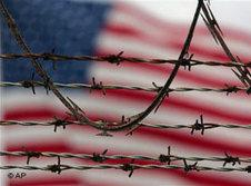US flag behind barbed wire (photo: AP)