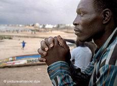 A Senegalese refugee after his return at the beach in Dakar (photo: dpa)