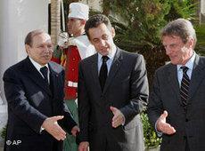 Bouteflika, Sarkozy, Kouchner (photo: AP)