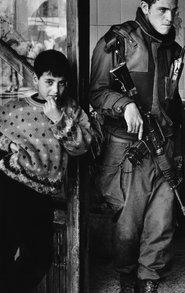 Israeli soldier and Palestinian boy (photo &copy Judah Passow)