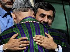Iranian president Mahmoud Ahmadinejad embracing Afghan President Hamid Karzai (photo: AP)