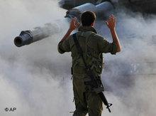 An Israeli soldier and tank in the Gaza strip (photo: AP)