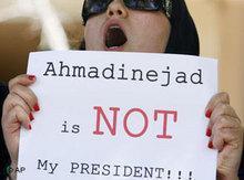 A woman demonstrating in Teheran (photo: AP)