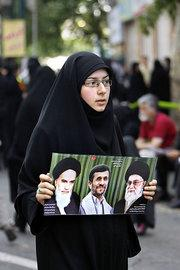 Young Iranian woman during a pro-Ahmadinejad rally in Tehran (photo: AP)