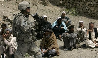 US military and Afghan civilians (photo: AP)