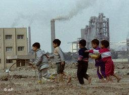 Children in Cairo playing next to an industrial site (photo: AP)