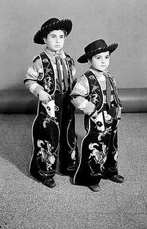 Two young boys dressed as cowboys (photo: Arab Image Foundation)
