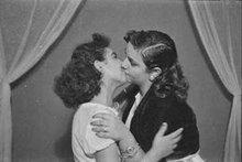 Two women kissing (photo: Arab Image Foundation)