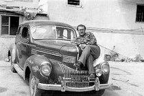 Man reclining on a car (photo: Arab Image Foundation)