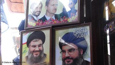 A photo montage showing Bashar al-Assad flanked by Hassan Nasrallah and Mahmoud Ahmadinejad on sale at a market (photo: Stefanie Markert/DW)