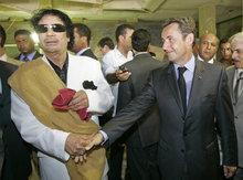 Libyan leader Muammar al-Gaddafi and French President Nicolas Sarkozy (photo: AP)
