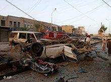 Cars destroyed in an attack in Kandahar in April 2010 (photo: AP)