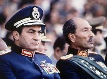 Former president of Egypt Anwar Al-Sadat and president Mubarak during a military parade in 1981 (photo: AP)