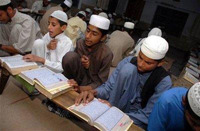 Students reading the Koran in a Punjabi madrasa, Pakistan (photo: AP)