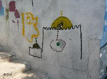 Grafiti on the wall of a demolished Palestinian house (photo: DW)