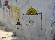 Grafiti on the wall of a demolished Palestinian house (photo: DW)