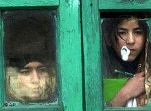 Kashmiri children watch a protest through a window in Srinagar, February 2007 (photo: AP)