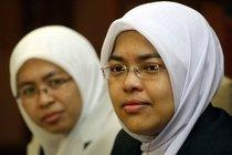 Rafidah Abdul Razak and Surayah Ramlee (photo: AP)