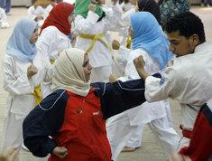 Headscarfed women during judo exercise (photo: AP)
