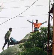 Hindus demolishing the Babri Mosque (photo: AP)