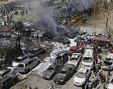 Burned-out cars after a bomb attack in Iraq (photo: AP)