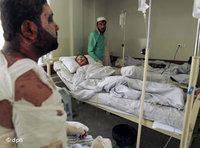Injured Afghans in a hospital in Kabul after the NATO air strike against hijacked road tankers near Kunduz (photo: AP)